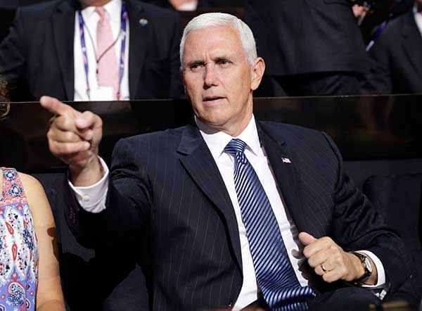 "<div class=""meta image-caption""><div class=""origin-logo origin-image none""><span>none</span></div><span class=""caption-text"">Vice Presidential nominee Gov. Mike Pence of Indiana points as he sits during the second day session of the Republican National Convention in Cleveland, Tuesday, July 19, 2016. (John Locher/AP Photo)</span></div>"
