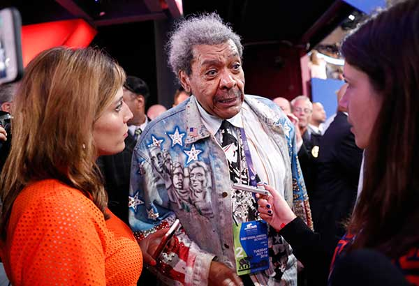 <div class='meta'><div class='origin-logo' data-origin='none'></div><span class='caption-text' data-credit='Carolyn Kaster/AP Photo'>Boxing promoter Don King talks to reporters on the convention floor during the second day session of the Republican National Convention in Cleveland.</span></div>