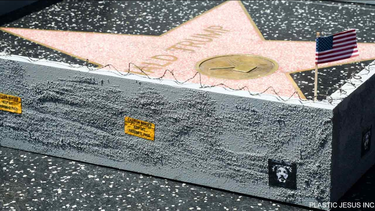 A street artist known as Plastic Jesus constructed a miniature wall around Donald Trump's star on the Hollywood Walk of Fame.