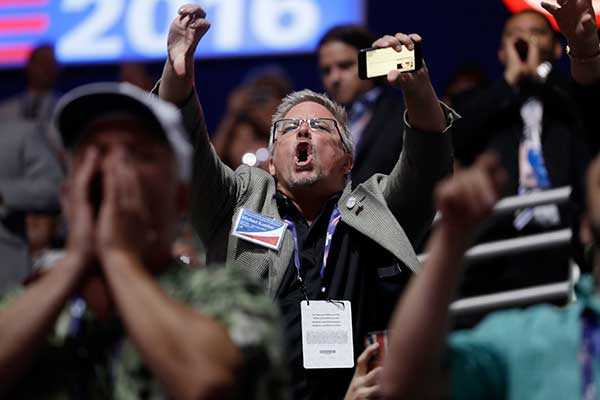 "<div class=""meta image-caption""><div class=""origin-logo origin-image none""><span>none</span></div><span class=""caption-text"">People react to Sen. Ted Cruz, R-Tex., as Cruz addresses the delegate during the third day session of the Republican National Convention in Cleveland, Wednesday, July 20, 2016. (Matt Rourke/AP Photo)</span></div>"