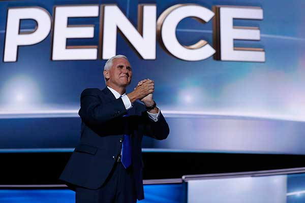 "<div class=""meta image-caption""><div class=""origin-logo origin-image none""><span>none</span></div><span class=""caption-text"">Republican vice presidential candidate Gov. Mike Pence, R-Ind., gestures as he arrives on stage to deliver his acceptance speech during the third day session of the RNC. (Mary Altaffer/AP Photo)</span></div>"