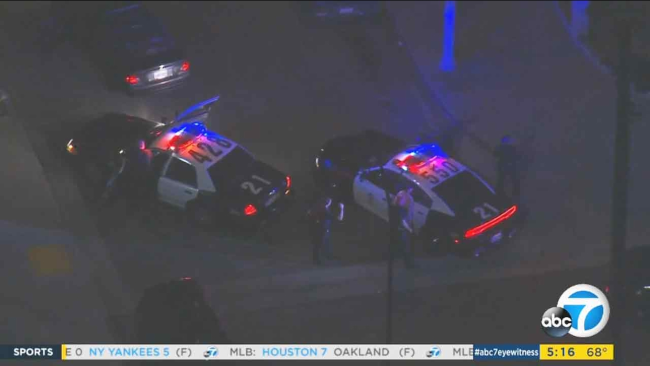 Police take one of several possible robbery suspects into custody following a chase through Los Angeles County early Thursday, July 21, 2016.