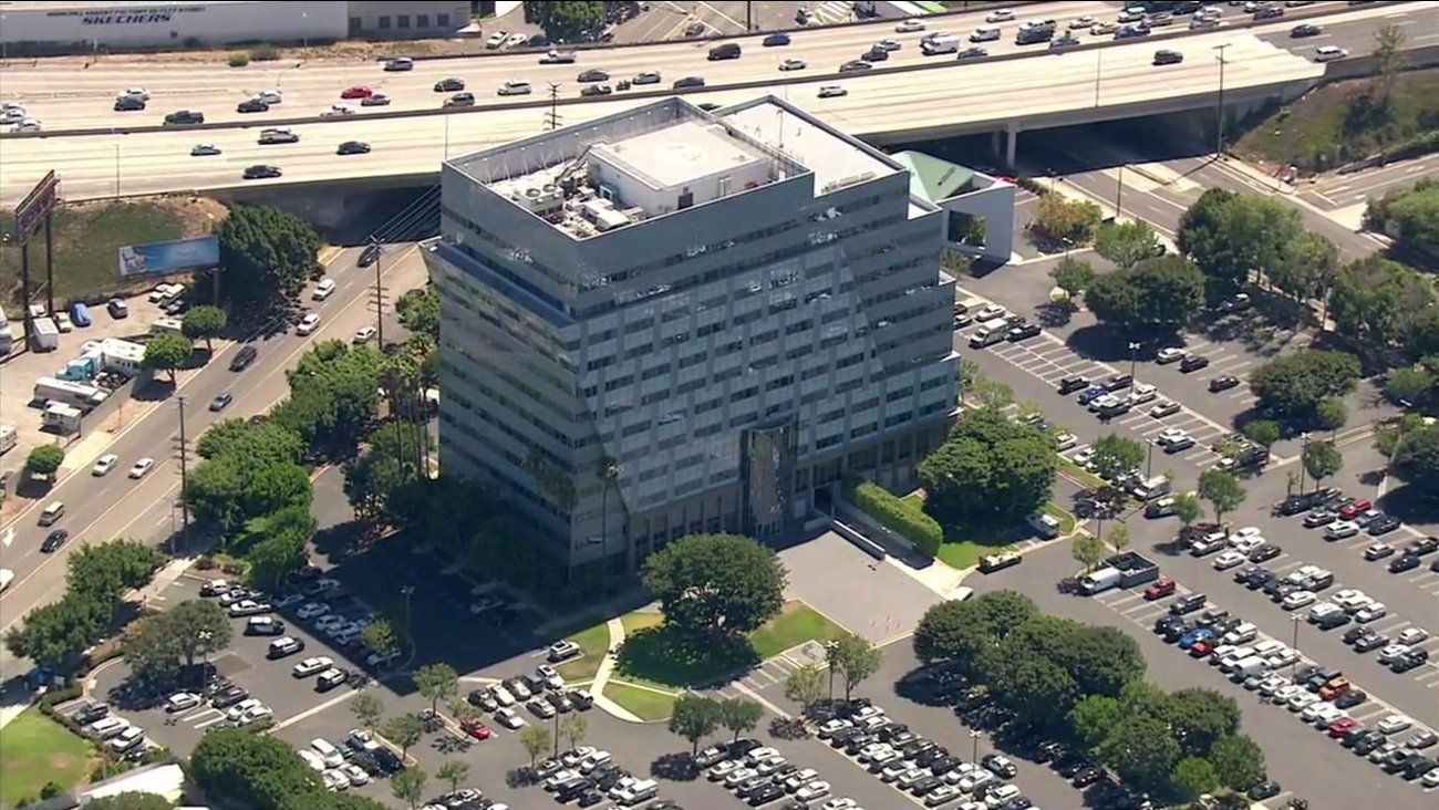 A building in Harbor Gateway was locked down after Los Angeles police received a report of a man with a gun on Thursday, July 21, 2016.