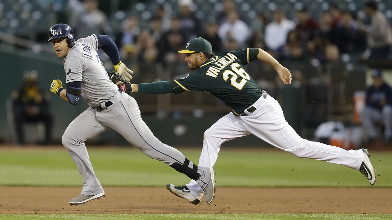 Oakland Athletics' Danny Valencia, right, tags out Tampa Bay Rays' Evan Longoria during a rundown between first and second base in a baseball game July 20, 2016.