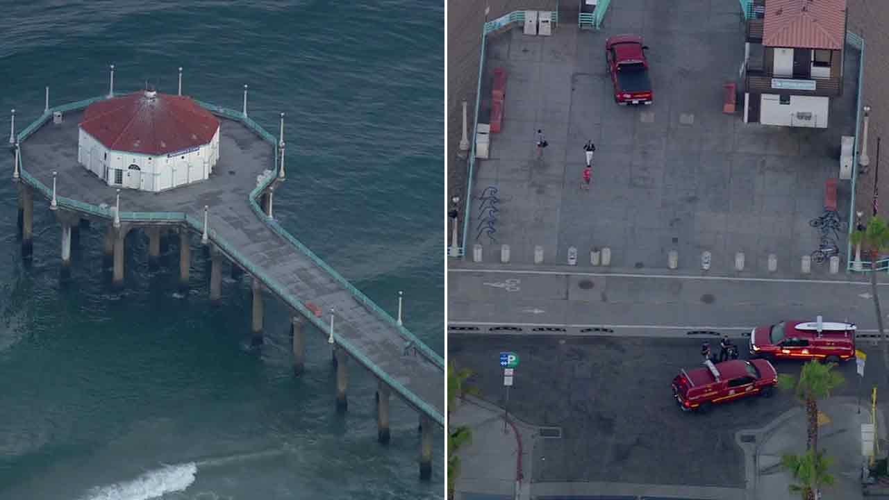Emergency vehicles are seen near the Manhattan Beach Pier on Friday, July 22, 2016.