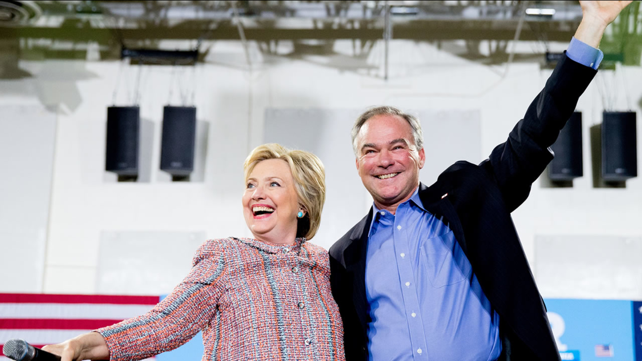 Democratic presidential candidate Hillary Clinton and Sen. Tim Kaine, D-Va., participate in a rally at Northern Virginia Community College in Annandale, Va. on July 14, 2016. (AP Photo/Andrew Harnik)