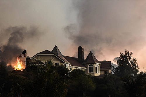 <div class='meta'><div class='origin-logo' data-origin='AP'></div><span class='caption-text' data-credit='AP Photo/Ryan Babroff'>A wildfire burns close to a home near Sand Caynon and Placerita Caynon in Santa Clarita, Calif., Saturday, July 23, 2016.</span></div>