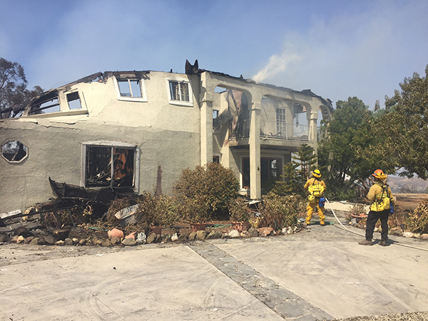 "<div class=""meta image-caption""><div class=""origin-logo origin-image ap""><span>AP</span></div><span class=""caption-text"">Firefighters hose down the remains of a burned home in Sand Canyon area near Santa Clarita, Calif., on Sunday, July 24, 2016. (AP Photo/Matt Hartman)</span></div>"