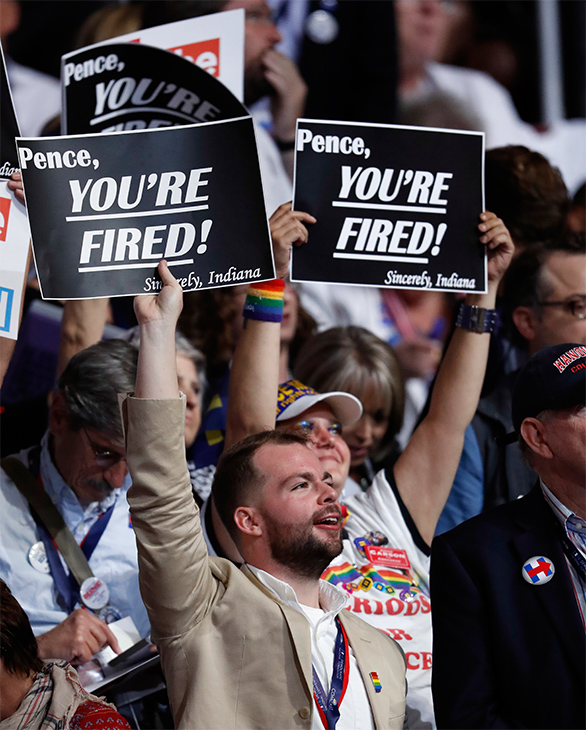 <div class='meta'><div class='origin-logo' data-origin='AP'></div><span class='caption-text' data-credit='Paul Sancya/AP'>Delegates hold signs during the second day of the Democratic National Convention in Philadelphia, July 26, 2016.</span></div>