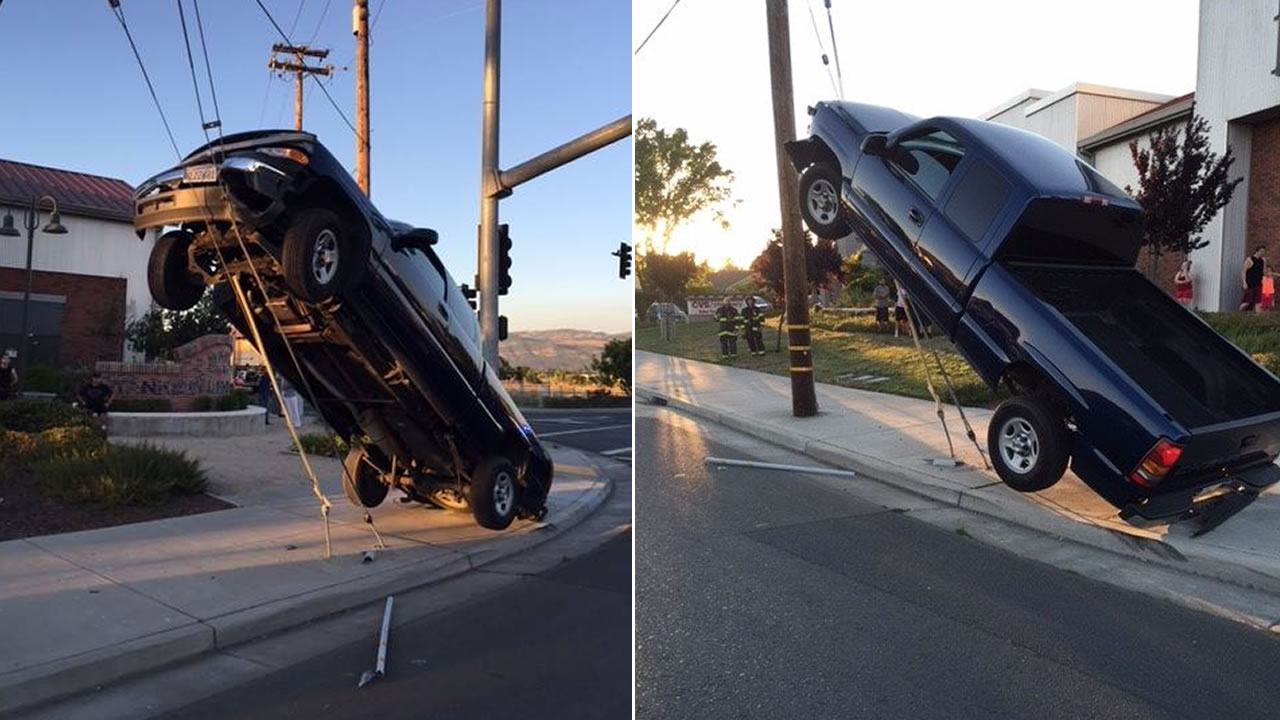 Police say a drunk driver drove off a road and ended up on the support wires of a power pole in Napa, Calif. on Tuesday, July 26, 2016.