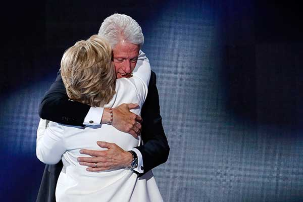 <div class='meta'><div class='origin-logo' data-origin='AP'></div><span class='caption-text' data-credit='J. Scott Applewhite/AP Photo'>Former President Bill Clinton hugs his wife Democratic presidential nominee Hillary Clinton during the final day of the Democratic National Convention in Philadelphia.</span></div>