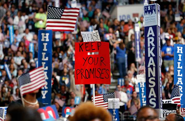 "<div class=""meta image-caption""><div class=""origin-logo origin-image none""><span>none</span></div><span class=""caption-text"">Delegates hold up signs during the final day of the Democratic National Convention in Philadelphia, Thursday, July 28, 2016. (Carolyn Kaster/AP Photo)</span></div>"