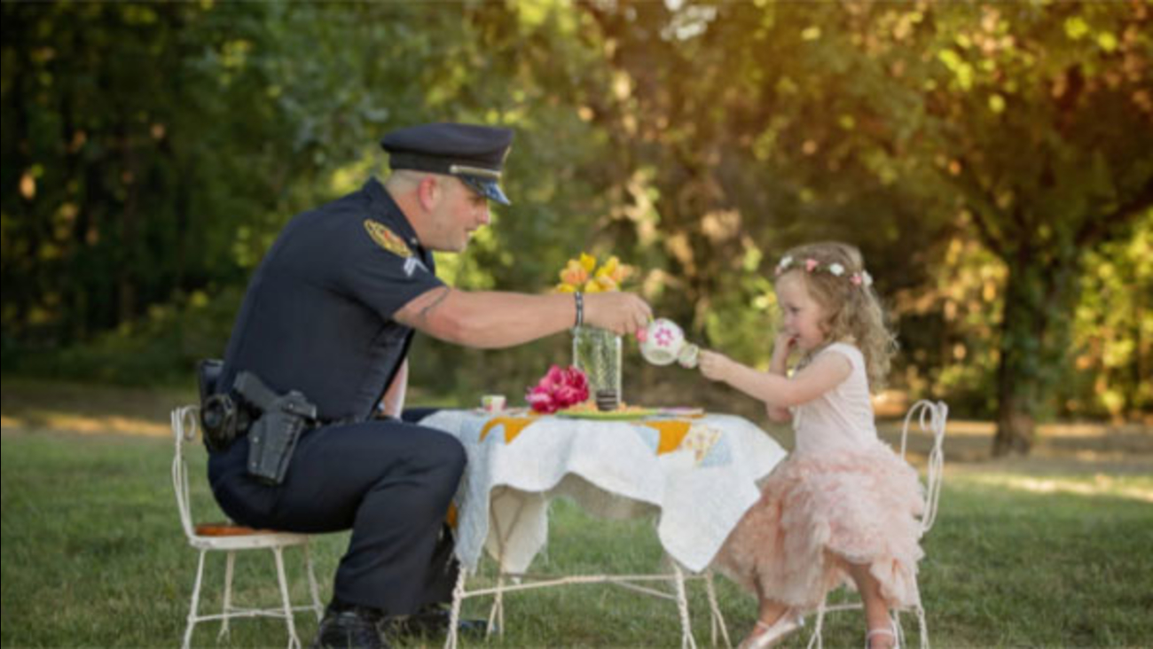 Police officer has 'tea party' with toddler whose life he saved