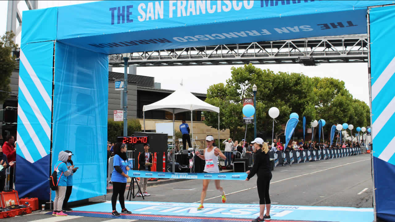 Max Haines-Stiles, 30, San Francisco, is the first to cross the finish line in the 39th Annual San Francisco Marathon on Sunday, July 31, 2016.