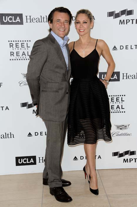 "<div class=""meta image-caption""><div class=""origin-logo origin-image ap""><span>AP</span></div><span class=""caption-text"">Robert Herjavec, left, and Kym Johnson arrive at the 4th Annual Reel Stories, Real Lives Benefit held at Milk Studios in Los Angeles. (Richard Shotwell/Invision/AP)</span></div>"