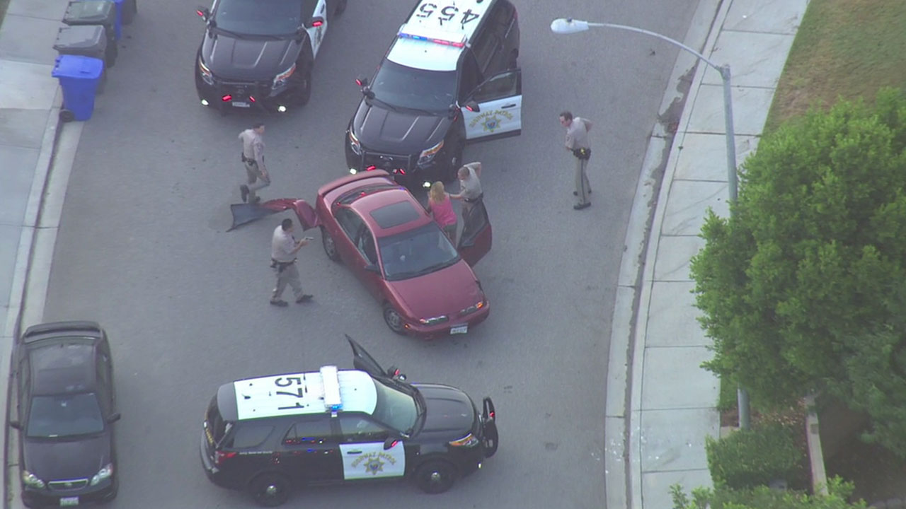 California Highway Patrol officers arrest a female suspect who led them on a chase through Los Angeles, Orange and San Diego counties on Monday, Aug. 1, 2016.