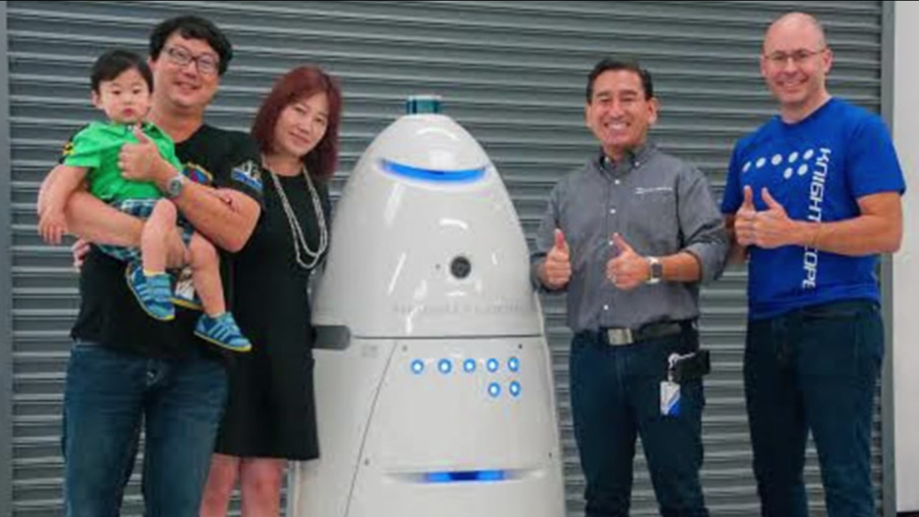Harwin Cheng and his family with employees of Knightscope in an undated photo in Mountain View, Calif.