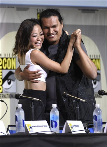 "<div class=""meta image-caption""><div class=""origin-logo origin-image none""><span>none</span></div><span class=""caption-text"">Karen Fukuhara, left, and Adam Beach attend the ""Suicide Squad"" panel on day 3 of Comic-Con International on Saturday, July 23, 2016, in San Diego. (Chris Pizzello/Invision/AP)</span></div>"