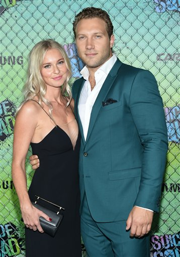 "<div class=""meta image-caption""><div class=""origin-logo origin-image none""><span>none</span></div><span class=""caption-text"">Actor Jai Courtney, right, and girlfriend Mecki Dent attend the world premiere of ""Suicide Squad"" at the Beacon Theatre on Monday, Aug. 1, 2016, in New York. (Evan Agostini/Invision/AP)</span></div>"