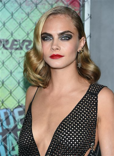 "<div class=""meta image-caption""><div class=""origin-logo origin-image none""><span>none</span></div><span class=""caption-text"">Cara Delevingne attends the world premiere of ""Suicide Squad"" at the Beacon Theatre on Monday, Aug. 1, 2016, in New York. (Photo by Evan Agostini/Invision/AP) (Evan Agostini/Invision/AP)</span></div>"