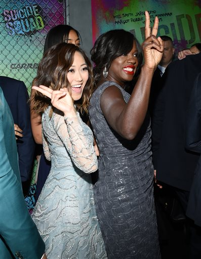 "<div class=""meta image-caption""><div class=""origin-logo origin-image none""><span>none</span></div><span class=""caption-text"">Karen Fukuhara, left, and Viola Davis give the peace sign as they arrive at the world premiere of ""Suicide Squad"" at the Beacon Theatre on Monday, Aug. 1, 2016, in New York. (Evan Agostini/Invision/AP)</span></div>"