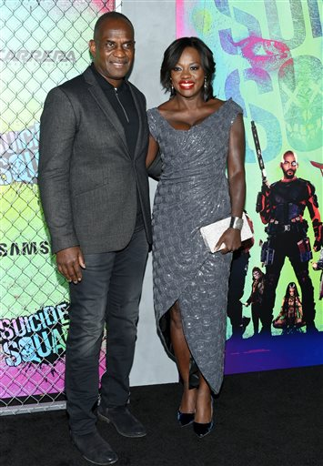 "<div class=""meta image-caption""><div class=""origin-logo origin-image none""><span>none</span></div><span class=""caption-text"">Julius Tennon, left, and Viola Davis attend the world premiere of ""Suicide Squad"" at the Beacon Theatre on Monday, Aug. 1, 2016, in New York. (Photo by Evan Agostini/Invision/AP) (Evan Agostini/Invision/AP)</span></div>"