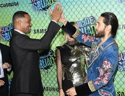 "<div class=""meta image-caption""><div class=""origin-logo origin-image none""><span>none</span></div><span class=""caption-text"">Actors Will Smith, left, Margot Robbie and Jared Leto attend the world premiere of ""Suicide Squad"" at the Beacon Theatre on Monday, Aug. 1, 2016, in New York. (Evan Agostini/Invision/AP)</span></div>"