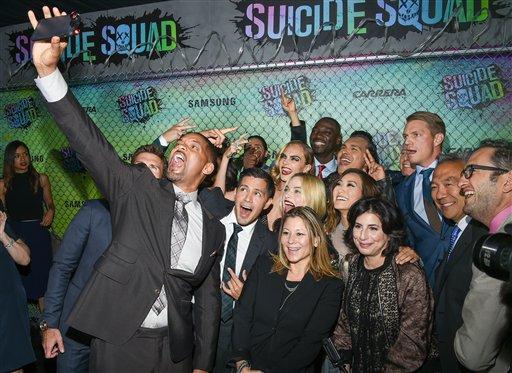 "<div class=""meta image-caption""><div class=""origin-logo origin-image none""><span>none</span></div><span class=""caption-text"">Actors Will Smith, left, Jay Hernandez, Margot Robbie, Cara Delevingne, Adam Beach and Adewale Akinnuoye-Agbaje pose for selfie at the world premiere of ""Suicide Squad"" (Evan Agostini/Invision/AP)</span></div>"