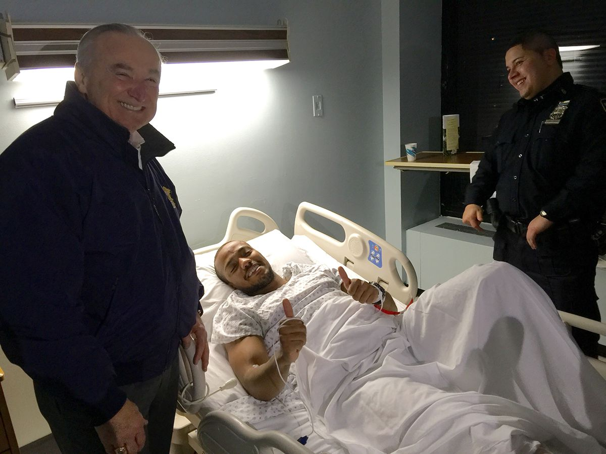 "<div class=""meta image-caption""><div class=""origin-logo origin-image ap""><span>AP</span></div><span class=""caption-text"">Officer Sherrod Stuart, center, poses with New York City Police Commissioner William Bratton, left, Saturday, Jan. 9, 2016, in New York. (NYPD via AP)</span></div>"