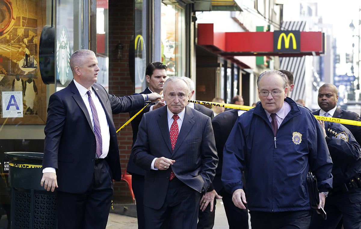 "<div class=""meta image-caption""><div class=""origin-logo origin-image ap""><span>AP</span></div><span class=""caption-text"">New York Police Department Commissioner William Bratton, center, walks to the scene of a fatal shooting, Monday, Nov. 9, 2015, in New York. (AP Photo/Mark Lennihan)</span></div>"