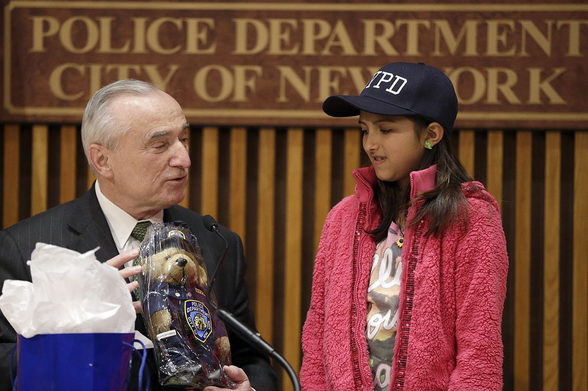 "<div class=""meta image-caption""><div class=""origin-logo origin-image ap""><span>AP</span></div><span class=""caption-text"">NYPD Commissioner Bill Bratton, left, presents Savannah Solis, of Tyler, Texas, a gift during a news conference at New York City police headquarters, Wednesday, Feb. 25, 2015. (AP Photo/Mary Altaffer)</span></div>"