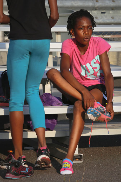 "<div class=""meta image-caption""><div class=""origin-logo origin-image ap""><span>AP</span></div><span class=""caption-text"">In this Wednesday, July 20, 2016 photo, Rainn Sheppard, 10, puts on her spikes as she prepares for track practice at Boys and Girls High School in the Brooklyn borough of New York. (Bebeto Matthews)</span></div>"