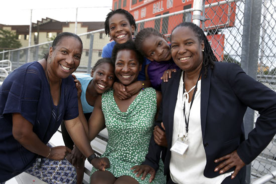 "<div class=""meta image-caption""><div class=""origin-logo origin-image ap""><span>AP</span></div><span class=""caption-text"">In this July 11, 2016 photo, Tonia Handy, 46, seated center, is surrounded by her children, Tai Sheppard, Rainn Sheppard and Brooke Sheppard, left to right, and flanked by coaches. (Richard Drew)</span></div>"