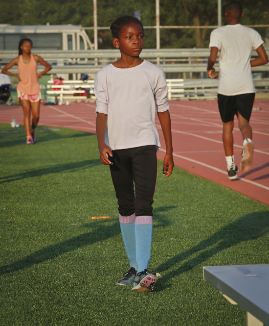 "<div class=""meta image-caption""><div class=""origin-logo origin-image ap""><span>AP</span></div><span class=""caption-text"">In this Wednesday, July 20, 2016 photo, Brooke Sheppard, 8, walks during a brief break during track practice at Boys and Girls High School in Brooklyn borough of New York. (Bebeto Matthews)</span></div>"