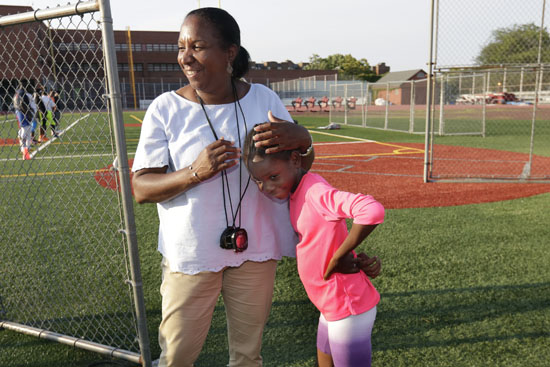 "<div class=""meta image-caption""><div class=""origin-logo origin-image ap""><span>AP</span></div><span class=""caption-text"">In this July 12, 2016 photo, Brooke Sheppard, 8, is hugged by one of her coaches Karel Lancaster, during training at Boys and Girls High School in the Brooklyn borough of New York. (Richard Drew)</span></div>"