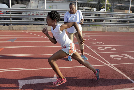 "<div class=""meta image-caption""><div class=""origin-logo origin-image ap""><span>AP</span></div><span class=""caption-text"">In this July 12, 2016 photo, coach Karel Lancaster times Rainn Sheppard, 10, during training at Boys and Girls High School, in the Brooklyn borough of New York. (Richard Drew)</span></div>"