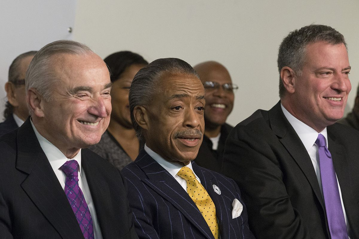"<div class=""meta image-caption""><div class=""origin-logo origin-image ap""><span>AP</span></div><span class=""caption-text"">Rev. Al Sharpton sits between newly-named New York police commissioner William Bratton, left, and Mayor-elect Bill de Blasio, right, on Saturday, Dec. 7, 2013. (AP Photo/John Minchillo)</span></div>"