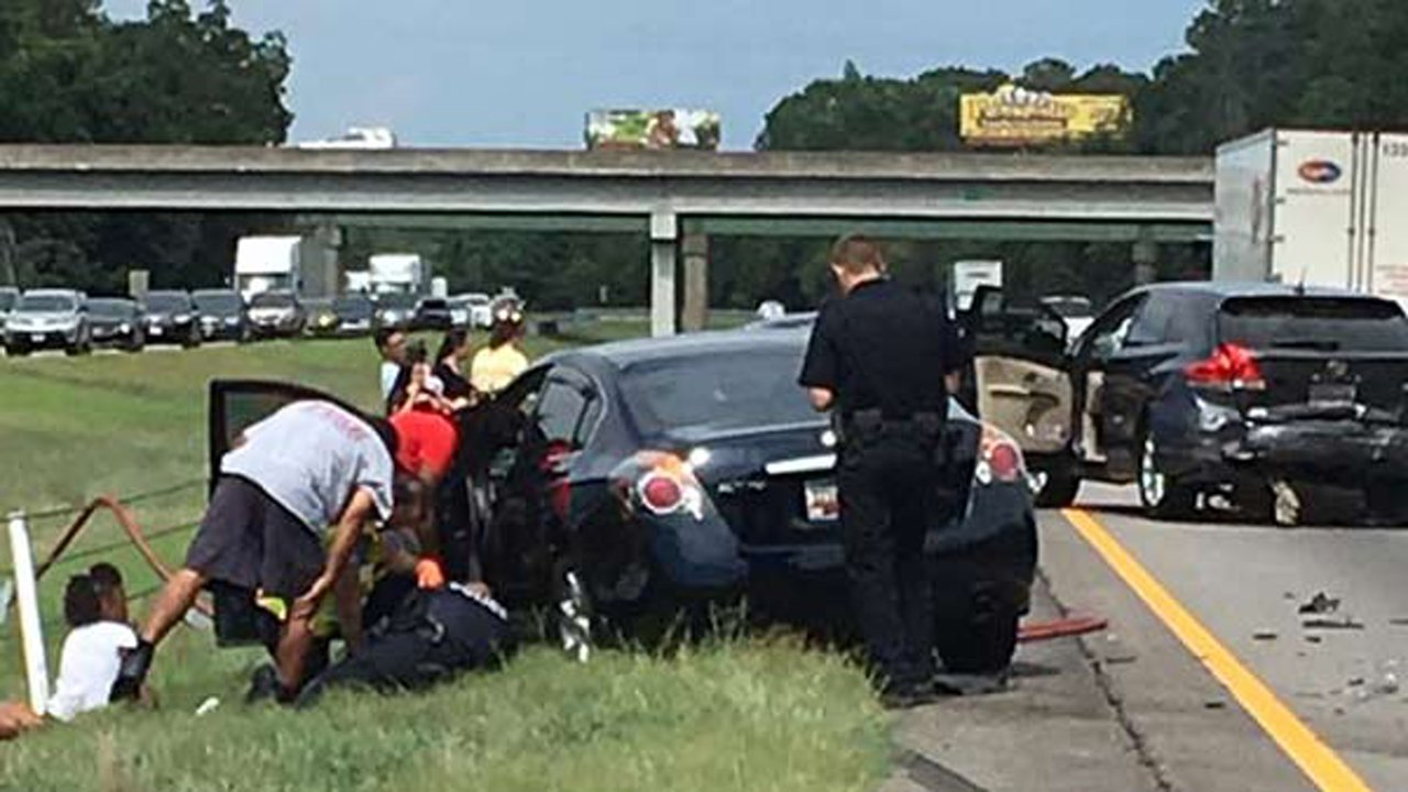 Police Officer Kay Denton posted a photo on Facebook showing her fellow officers responding to a car accident on the highway on July 30.