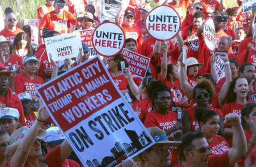 <div class='meta'><div class='origin-logo' data-origin='none'></div><span class='caption-text' data-credit='AP'>Striking union members rally outside the Trump Taj Mahal casino in Atlantic City, N.J.</span></div>