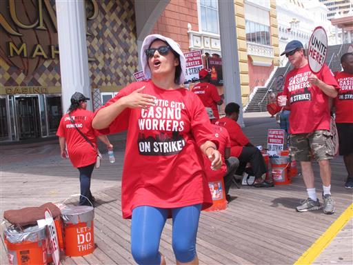 <div class='meta'><div class='origin-logo' data-origin='none'></div><span class='caption-text' data-credit=''>Striking union members rally outside the Trump Taj Mahal casino in Atlantic City, N.J.</span></div>
