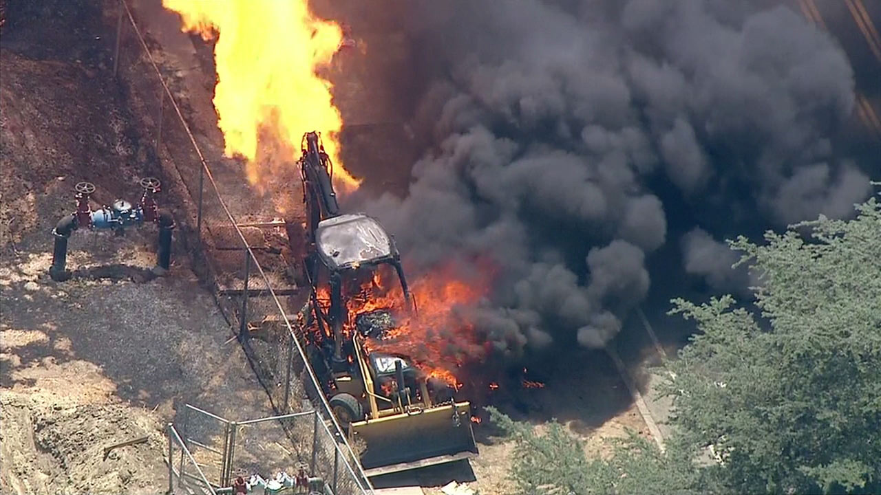 A fire erupted in Woodland Hills after a backhoe struck a gas line and sparked a fire on Wednesday, Aug. 3, 2016.