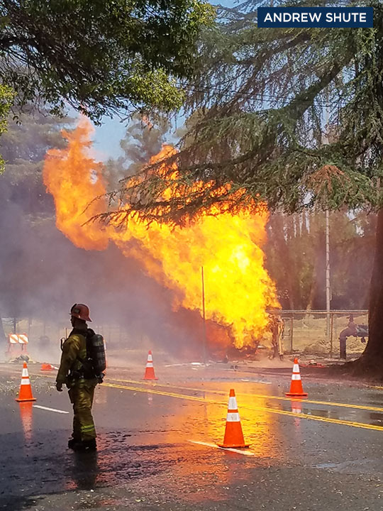 A firefighter works to put out a fire at the scene of a gas main break in Woodland Hills on Wednesday, Aug. 3, 2016.