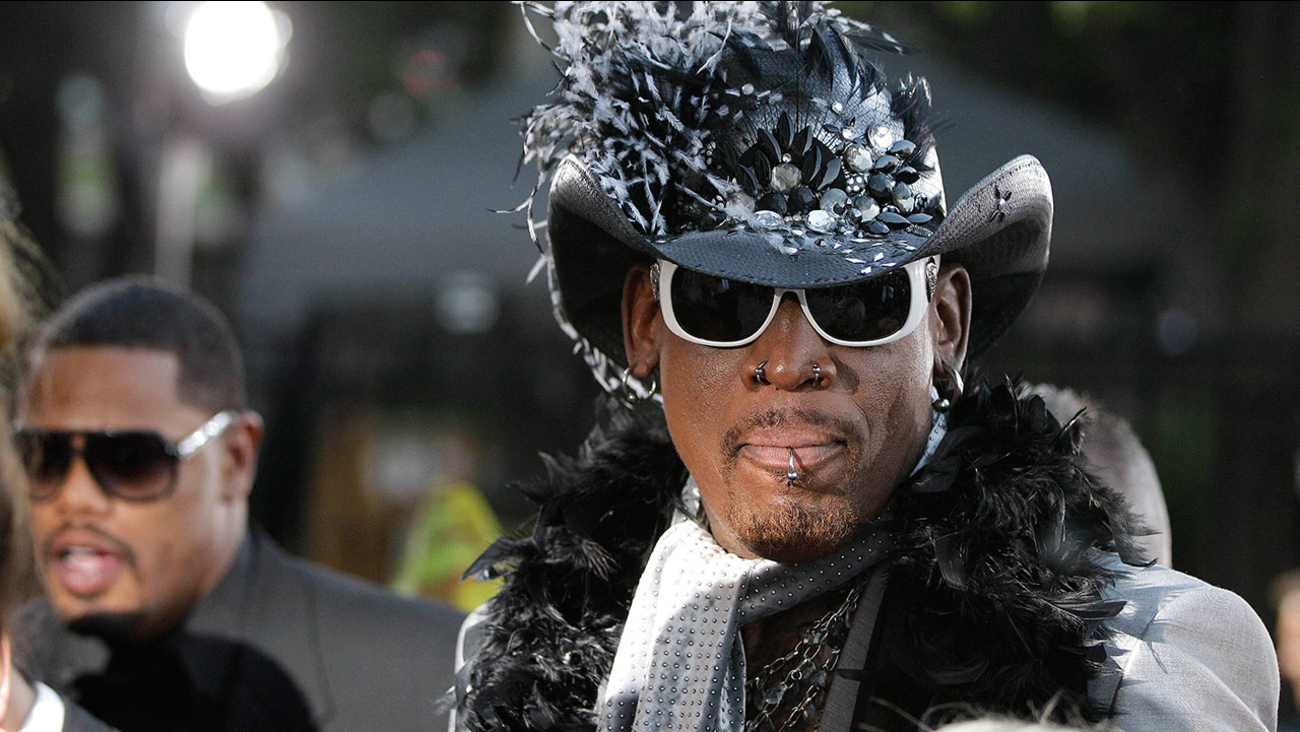 Former Chicago Bulls forward Dennis Rodman arrives at the Basketball Hall of Fame enshrinement ceremony in Springfield, Mass., on Friday night, Aug. 12, 2011.