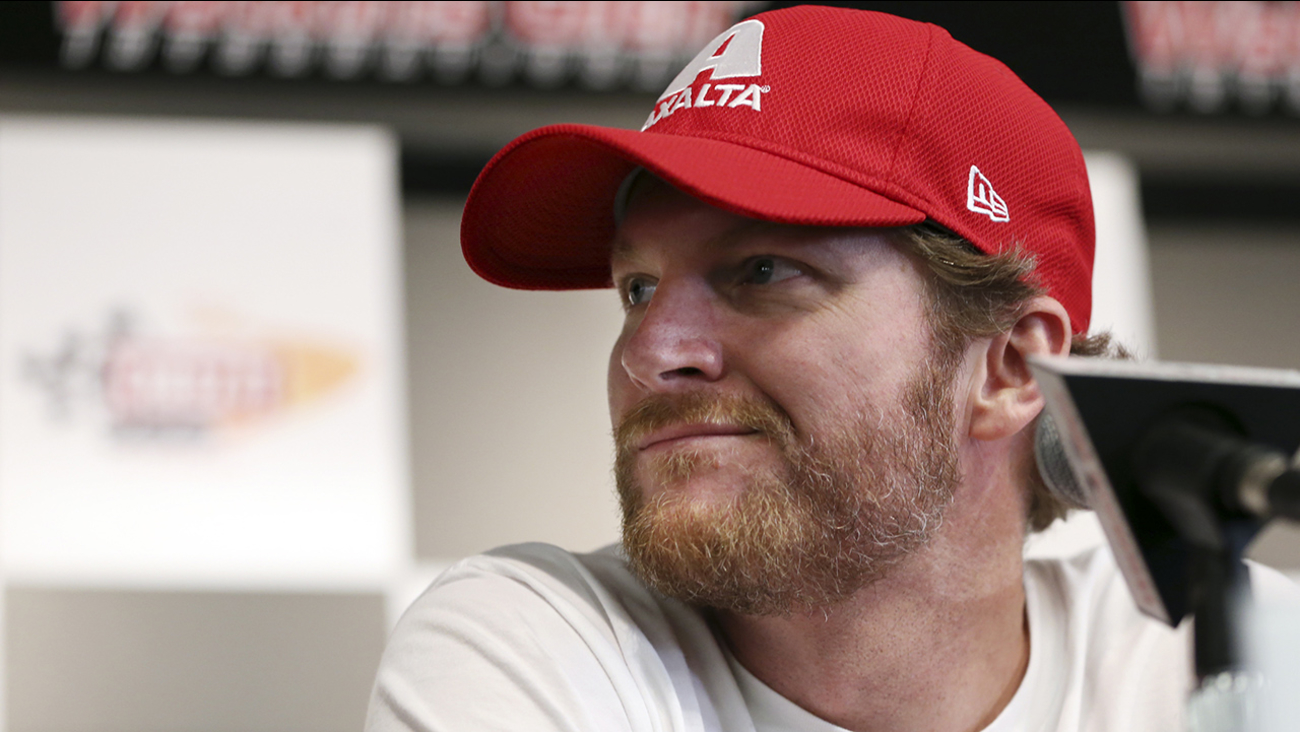 Dale Earnhardt Jr. listens to a question about his concussion while addressing the media at Watkins Glen International racetrack during practice