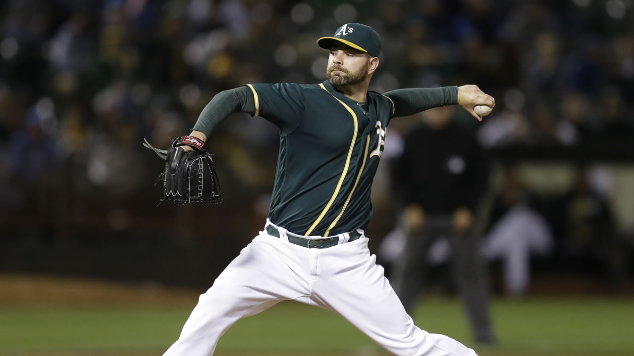 Oakland Athletics pitcher Marc Rzepczynski works against the Chicago Cubs in the ninth inning of a baseball game Friday, Aug. 5, 2016, in Oakland, Calif.