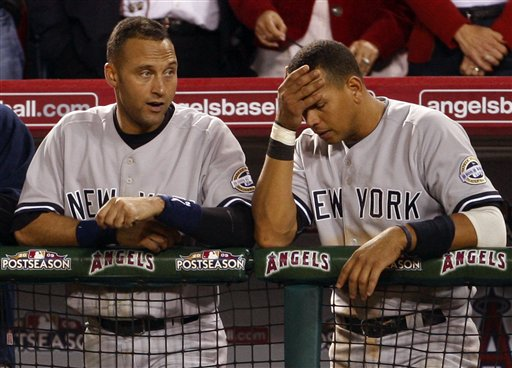 <div class='meta'><div class='origin-logo' data-origin='AP'></div><span class='caption-text' data-credit='ASSOCIATED PRESS'>New York Yankees' Alex Rodriguez, right, and Derek Jeter react as they watch the ninth inning of Game 5 of the American League Championship baseball series.</span></div>