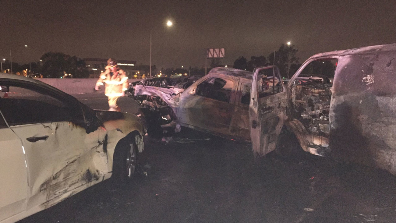 Authorities investigated the scene of a fiery multi-vehicle crash on the 5 Freeway in Tustin on Monday, Aug. 8, 2016.