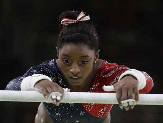 "<div class=""meta image-caption""><div class=""origin-logo origin-image ap""><span>AP</span></div><span class=""caption-text"">United States' Simone Biles performs on the uneven bars (AP Photo/Julio Cortez)</span></div>"