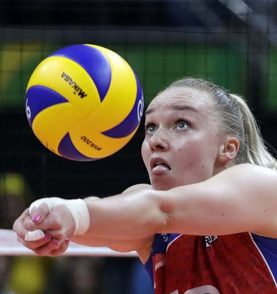 "<div class=""meta image-caption""><div class=""origin-logo origin-image ap""><span>AP</span></div><span class=""caption-text"">Russia's Ekaterina Kosianenko bumps during a women's preliminary volleyball match (AP Photo/Jeff Roberson)</span></div>"