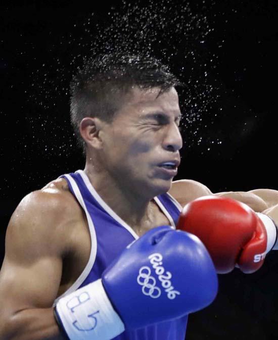 """<div class=""""meta image-caption""""><div class=""""origin-logo origin-image ap""""><span>AP</span></div><span class=""""caption-text"""">Ecuador's Carlos Eduardo Quipo Pilataxi during a men's light flyweight preliminary boxing match (AP Photo/Frank Franklin II)</span></div>"""